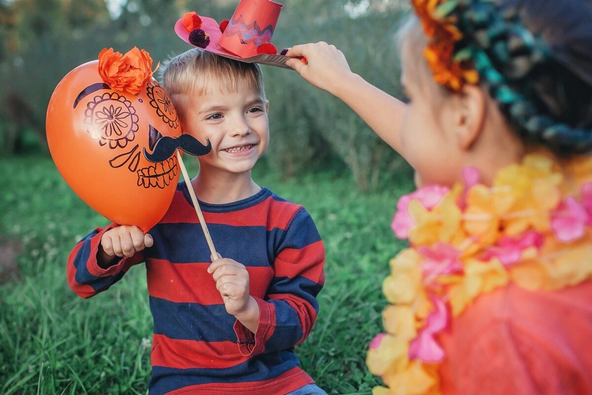 Day of the Dead and Halloween. Cute kids wearing in themed costumes for fun party
